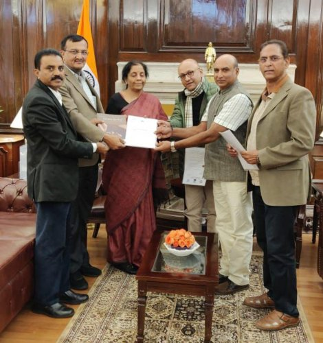 A delegation of coffee growers submits a memorandum to Union Finance Minister Nirmala Sitharaman.