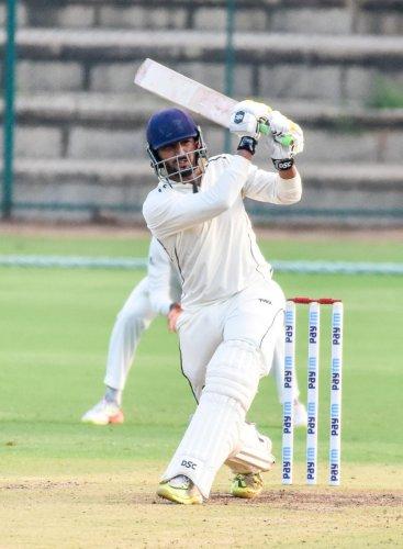Rishi Dhawan of Himachal Pradesh slams one to the fence during his unbeaten 72 against Karnataka in Mysuru on Thursday. DH Photo/ B R Savitha