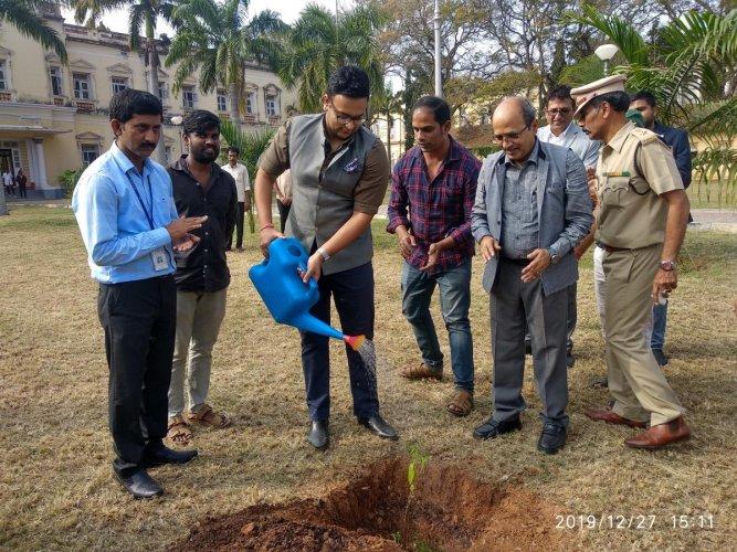 Royal scion Yaduveer Krishnadatta Chamaraja Wadiyar plants a sandalwood sapling to mark his visit to CSIR-Central Food Technological Research Institute (CFTRI), in Mysuru, on Friday. CFTRI Director K S M S Raghava Rao and India-head of Silicon Road S Sanj