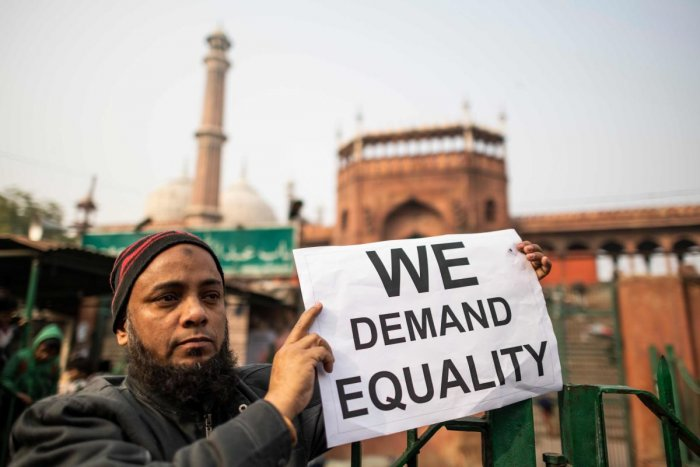 A protester displays a placard during a demonstration against India's new citizenship law outside the Jama Masjid mosque in New Delhi on December 27, 2019. Photo/AFP