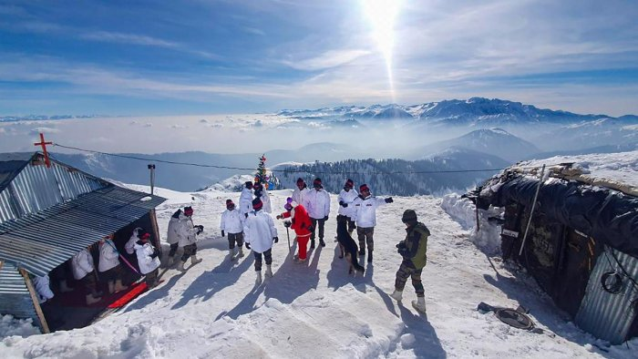 Army jawans celebrate Christmas outside their camps at a snow-covered mountain in north Kashmir, Wednesday, Dec. 25, 2019. (PTI Photo)