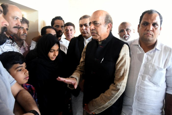 TMC leaders Nadimul Haque and Dinesh Trivedi meet the family members of Jaleel, who was killed in police firing during a protest against Citizenship (Amendment) Act, at Kandak in Mangaluru on Saturday. DH Photo