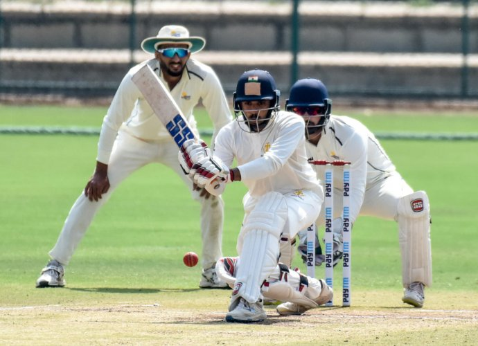 Karnataka's BR Sharath attempts to sweep during his 42-run knock against Himachal Pradesh on Saturday. DH PHOTO/ SAVITHA BR