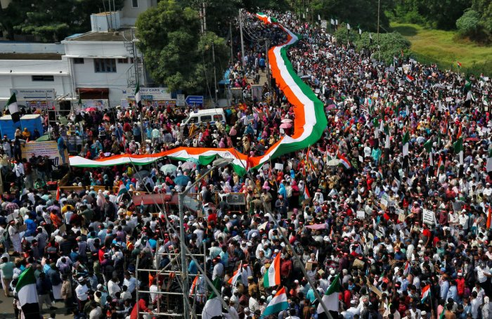 Demonstrators carry flags and placards as they attend a protest rally, organised by Tamil Nadu Thowheed Jamath, a Muslim religious group, against a new citizenship law, in Chennai. (PTI Photo)