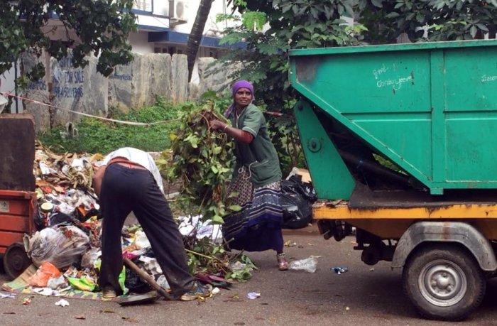 Pourakarmika collects waste at Indiranagar in Bengaluru.