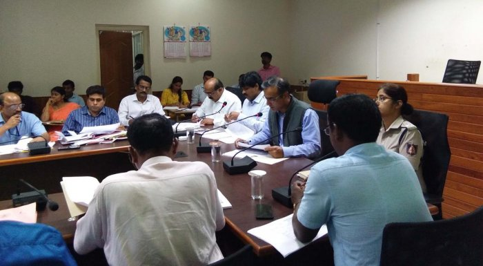 District In-charge Secretary M Maheshwar Rao chairs a district-level review meeting at the deputy commissioner's office in Manipal.
