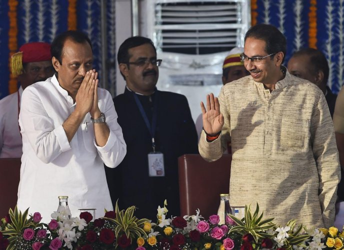 NCP leader Ajit Pawar with Chief Minister Uddhav Thackeray during the swearing in ceremony for Maharashtra cabinet expansion at Vidhan Bhavan in Mumbai
