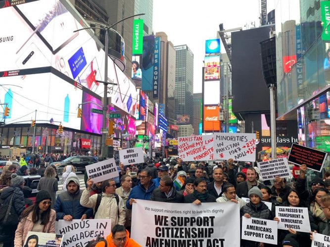 A group of Indian-Americans gathered at Times Square on Sunday, carrying placards and raising slogans in support of the Narendra Modi government and CAA. Photo/Twitter (@ThakurRanjitDas)