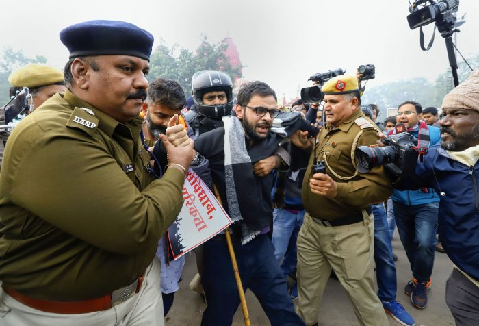 Former JNU student and activist Umar Khalid is detained by police for defying prohibitory orders imposed by the Delhi Police in the area during an anti-Citizenship Act protest, at Red Fort, in New Delhi. (PTI Photo)