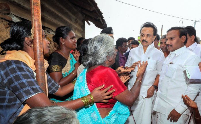 DMK Leader MK Stalin with Nilgiri MP A Raja consoles people at the site of the wall collapse in Nadur village of Mettupalayam taluk, near Coimbatore, Tuesday, Dec. 3, 2019. 17 people were killed in the incident after the compound wall of three tile roofed houses collapsed on them. (PTI Photo)