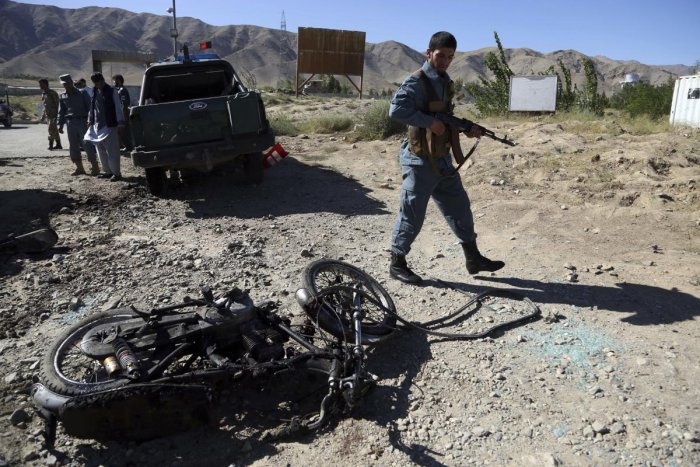 Afghan police inspect the site of a suicide attack, in northern Parwan province, Afghanistan, Tuesday, Sept. 17, 2019. (AP Photo)