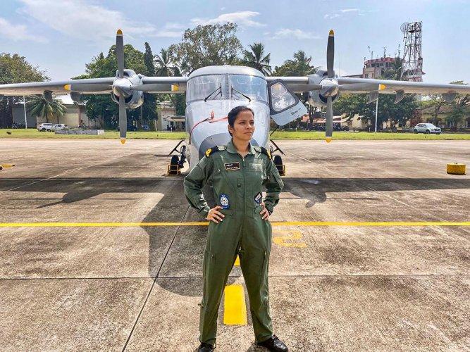 Sub-lieutenant Shivangi stands infront of the Dornier surveillance aircraft. (PTI Photo)