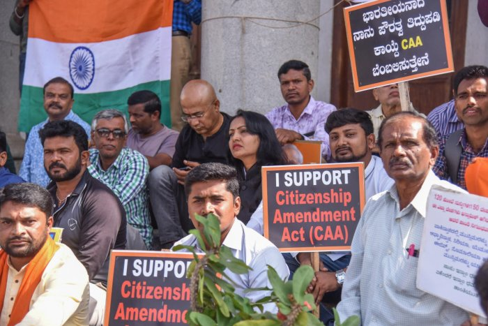 People protest in support of the Citizenship Amendment Act in front of Town Hall in Bengaluru on Sunday. DH PHOTO/S K DINESH