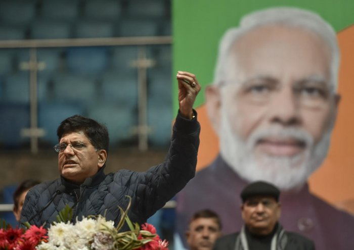 Union Railways Minister Piyush Goyal addresses a gathering during a traders' convention at Talkatora Stadium