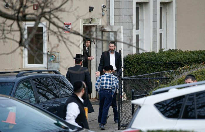 Members of the Jewish community leave from a synagoge next to the home of rabbi, Chaim Rottenbergin Monsey, in New York on December 29, 2019 after a machete attack that took place earlier outside the rabbi's home during the Jewish festival of Hanukkah in Monsey, New York. AFP
