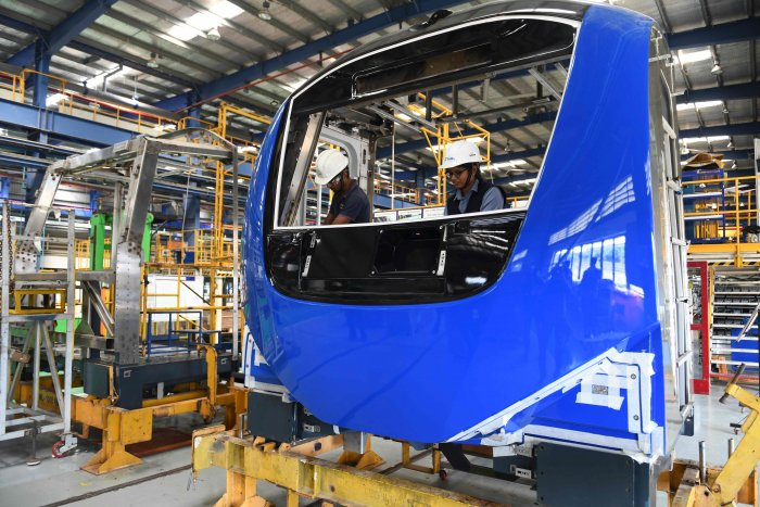 Alstom employees work on the new carriage model of the Mumbai Metro Line 3. (AFP Photo)