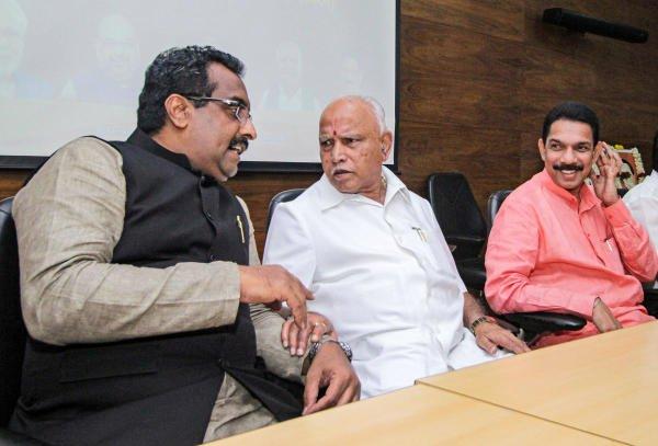 Karnataka Chief Minister B. S. Yediyurappa, BJP National Secratary Rama Madhav and BJP State President Nalin Kumar Kateel during a meeting for Citizenship Amendment Act in Bengaluru, Monday, Dec. 30, 2019. (PTI Photo)