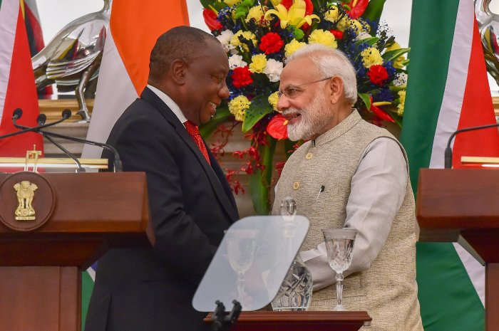 Prime Minister Narendra Modi and South African President Cyril Ramaphosa exchange greetings during the joint statement following a meeting at Hyderabad House, in New Delhi. (PTI Photo)