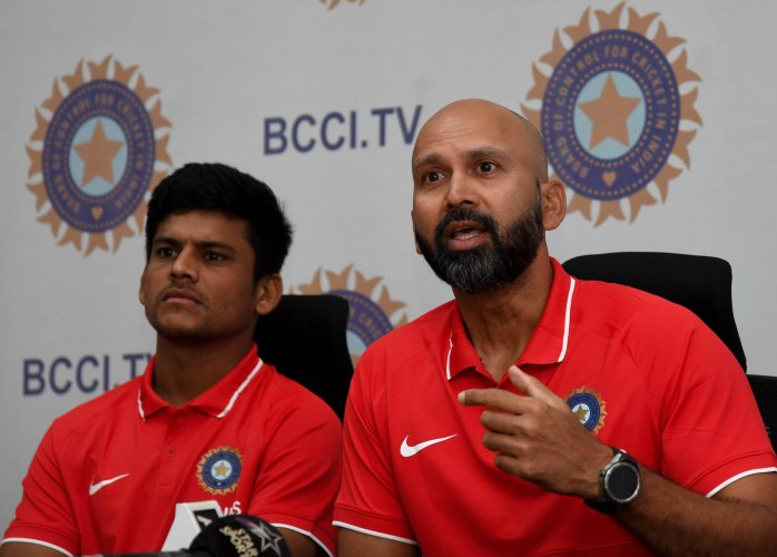 Head Coach(Right) and Priyam Garg, Captain of Indian Team Under-19 Cricket are seen during the Pre-departure press conference on World Cup 2020. (DH Photo)