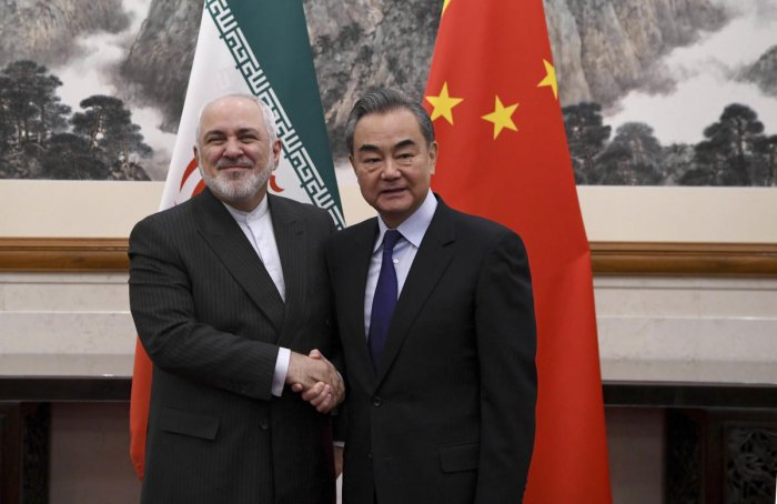 China's Foreign Minister Wang Yi, right, shakes hands with Iran's Foreign Minister Mohammad Javad Zarif. (AP/PTI photo)