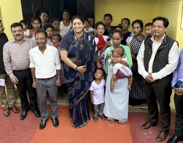 Women and Child Development (WCD) Minister Smriti Irani with Meghalaya Chief Minister Conrad Sangma visits 'Umdihar Anganwadi Centre' to oversee the implementation of 'Poshan Abhiyaan', in Shillong, Monday, Aug. 26, 2019. (PTI Photo)