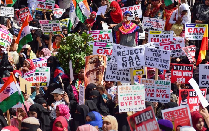 Members of Women India Movement display placards and raise slogans during a protest against the Citizenship Amendment Act (CAA), National Register of Citizenship (NRC) and National Population Register (NPR), in Bengaluru, Thursday, Dec. 26, 2019. (PTI Pho