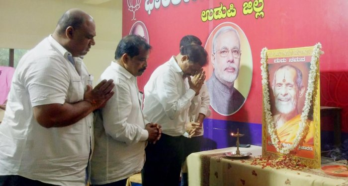 BJP leaders pay tributes to Pejawar seer Vishwesha Theertha Swami during a condolence meeting organised at BJP Office in Udupi.