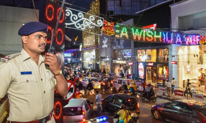 A police officer stationed at Brigade Road ahead of New Year's Eve celebrations on Monday. DH PHOTO/S K DINESH