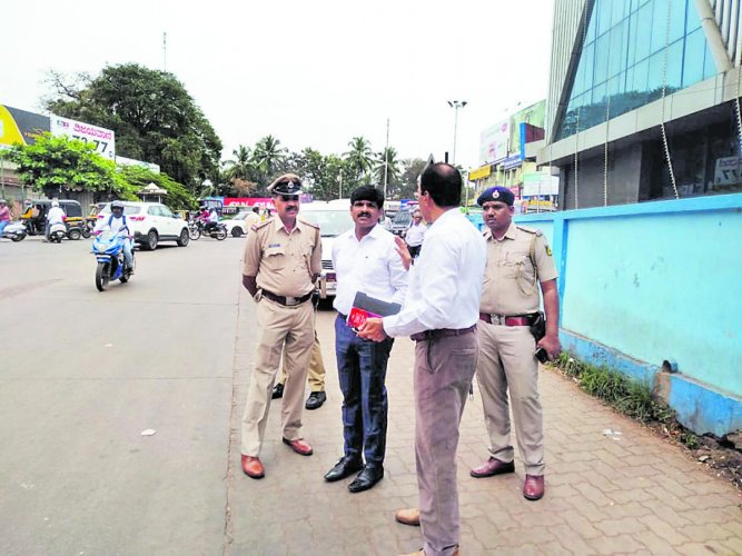 Udupi Deputy Commissioner G Jagadeesha collects information on the violence that broke out during anti-Citizen (Amendment) Act protest on December 19,in Mangaluru on Monday.