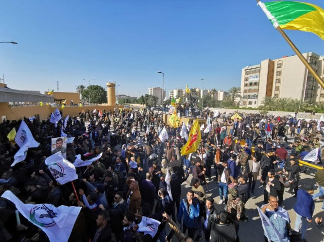 Protesters and militia fighters gather to condemn air strikes on bases belonging to Hashd al-Shaabi (paramilitary forces), outside the main gate of the U.S. Embassy in Baghdad, Iraq December 31, 2019. (Reuters Photo)