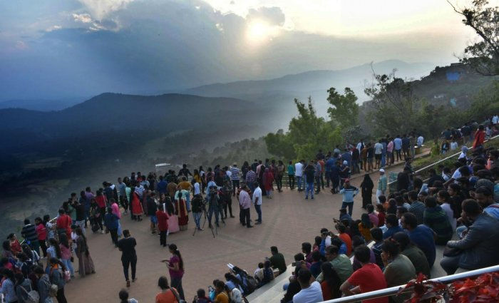 People witness the last sunset of 2019, at the viewing point in Raja Seat on Tuesday evening.