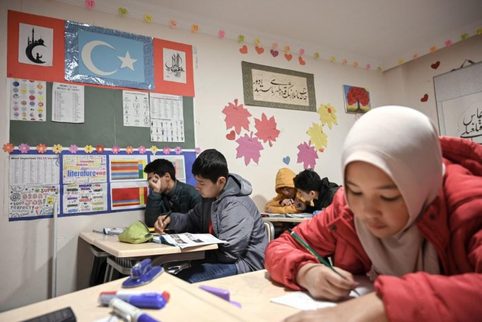 Uighur childen attend a science lesson in a school of Silivri district in Istanbul on November 29, 2019. Out of just over a hundred pupils at the school, 26 have lost one parent to the camps, seven have lost both, says its head Habibullah Kuseni. Photo/AFP