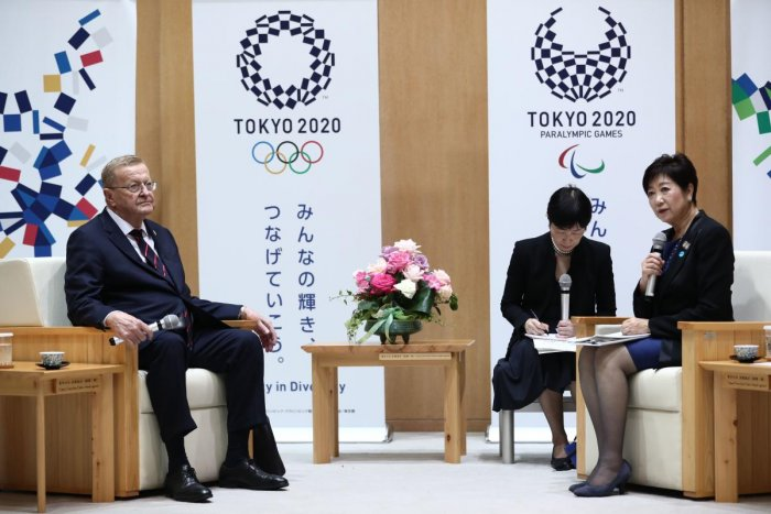 """Tokyo Governor Yuriko Koike (R) meets with Chairman of the Tokyo 2020 Olympic Games coordination committee, John Coates in Tokyo on October 25, 2019. - Tokyo's governor said October 25 she opposes moving next year's Olympic marathon and race-walking events to northern Japan over heat fears, describing the proposal as a """"bolt from the blue."""" AFP"""
