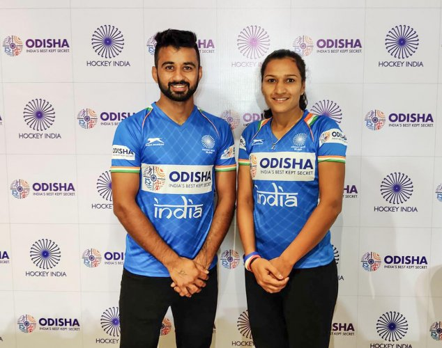 Manpreet Singh and Rani Rampal, skippers of India's men's and women's hockey teams selected for FIH Hockey Olympics Qualifiers Odisha, pose for photographs in Bhubaneswar, Odisha, Friday, Oct. 18, 2019. (PTI Photo)