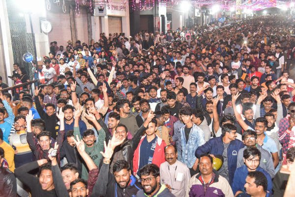 People celebrating new year at Brigade Road in Bengaluru on Tuesday night. Photo by S K Dinesh