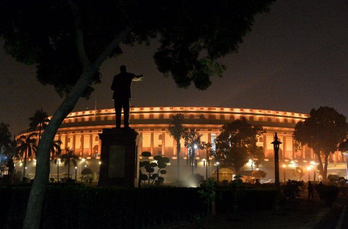 A view of illuminated Parliament House building during the ongoing Winter Session, in New Delhi. (PTI Photo)