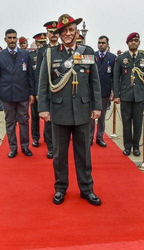 India's first Chief of Defence Staff (CDS) Gen Bipin Rawat poses for photographs after inspecting the Guard of Honour at South Block lawns in New Delhi