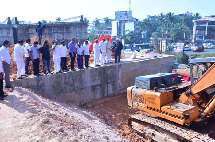 Members of a fact-finding committee of the Congress inspect the work on the Pumpwell flyover.