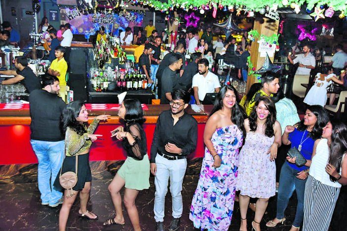 Revellers at a New Year party in Mangaluru on Tuesday evening.