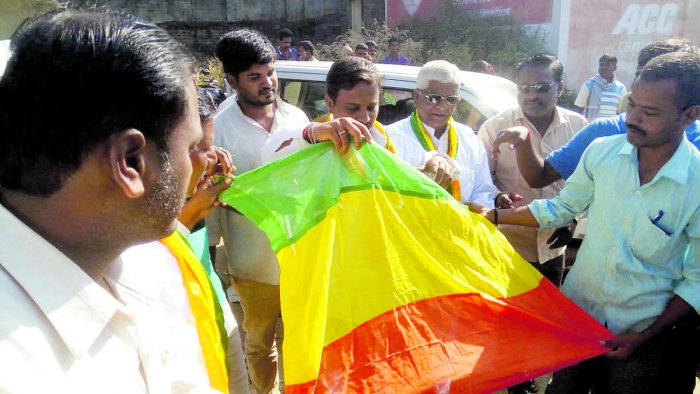 Uttara Karnataka Horata Samithi activists hold a flag during a protest demanding separate statehood for north Karnataka at Hirebagewadi in Belagavi taluk on Wednesday.