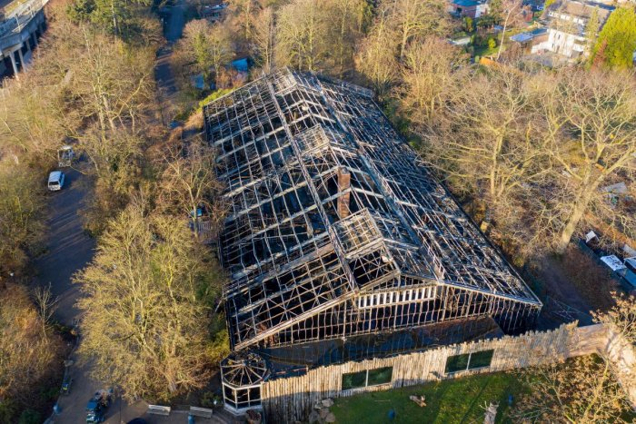 Aerial view shows the burned-out monkey house of the zoo in Krefeld, western Germany, on January 1, 2020. AFP