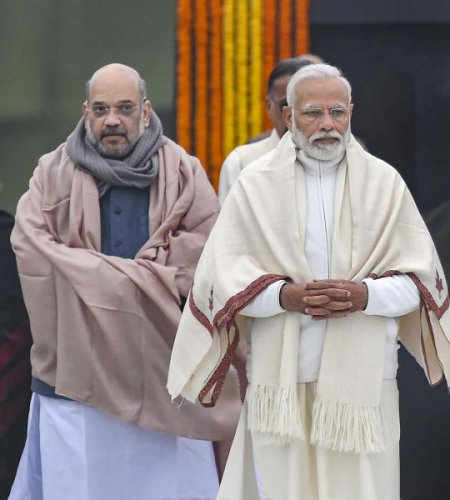 Prime Minister Narendra Modi and Home Minister Amit Shah, arrive to pay tributes to former prime minister A B Vajpayee on his 95th birth anniversary at his memorial, Sadaiv Atal,, in New Delhi, Wednesday, Dec. 25, 2019. (PTI Photo/Kamal Kishore)