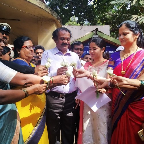 Mahila Congress members presented roses to the staff at Union Minister Pralhad Joshi's office in Hubballi.