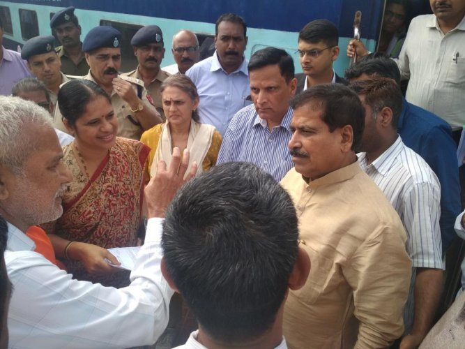 Minister of State for Railways Suresh Angadi meets the public during his visit to Birur Railway Station.