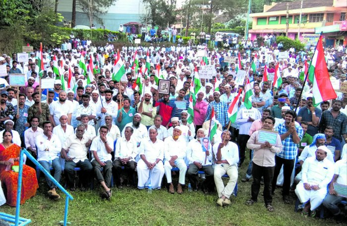 Hundreds of people take part in a protest against the Citizenship (Amendment) Act,at Church grounds in Siddapura on Friday.