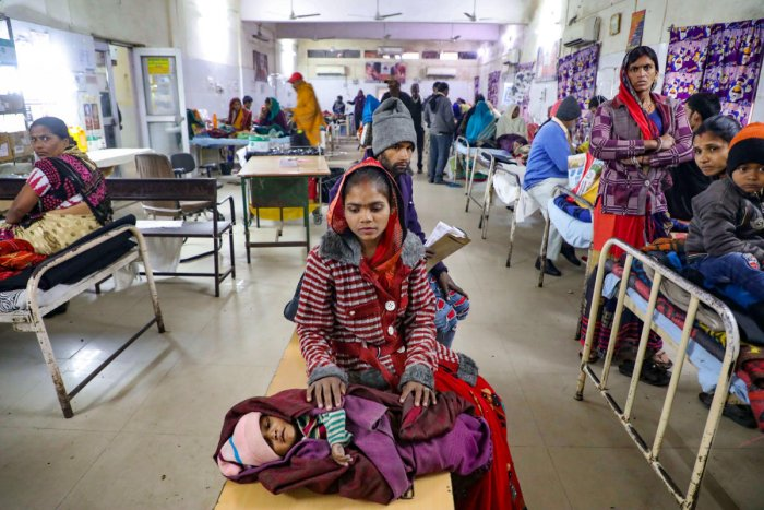 A mother waits for treatment of her child at the JK Lon hospital, in Kota district, Thursday, Jan. 2, 2020. At least 100 infants have died at a government-run hospital in Kota in the past month. (PTI Photo)