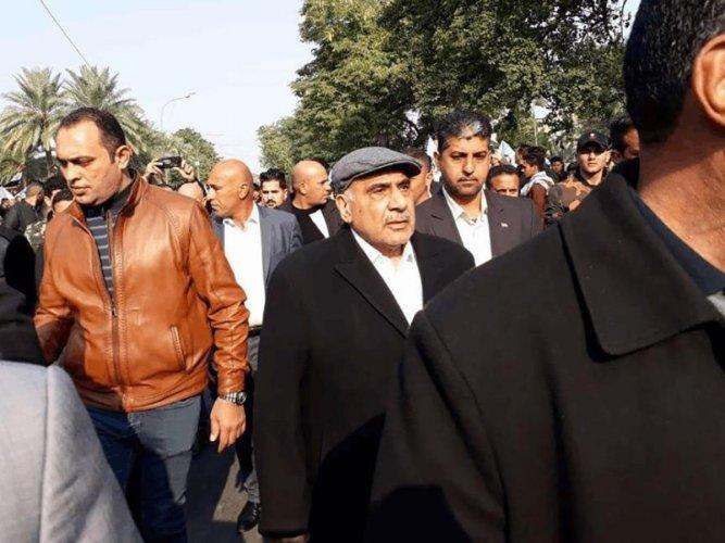 Iraq's caretaker prime minister Adel Abdel Mahdi (C-R) arriving for the funeral of Iranian military commander Qasem Soleimani and Iraqi paramilitary chief Abu Mahdi al-Muhandis in Baghdad's district of al-Jadriya. (AFP photo)