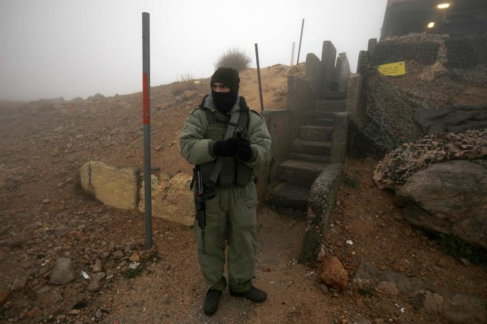 An Israeli soldier based in a military zone in a ski resort patrols an area in Mount Hermon in the Israeli-annexed Golan Heights from the Syrian side. (AFP Photo)