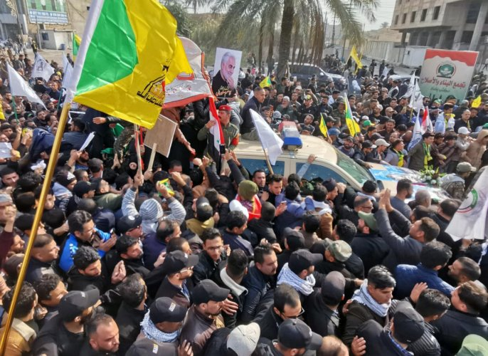 Mourners attend the funeral of the Iranian Major-General Qassem Soleimani, top commander of the elite Quds Force of the Revolutionary Guards, and the Iraqi militia commander Abu Mahdi al-Muhandis, who were killed in an air strike at Baghdad airport, in Baghdad, Iraq. (Reuters photo)