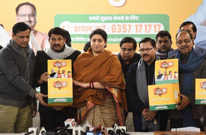 Union minister Smriti Irani along with Delhi BJP President Manoj Tiwari and senior leaders Shyam Jaju and Vijay Goel launches the party's 'Meri Dilli, Mera Sujhav' abhiyaan, in New Delhi. (PTI Photo)